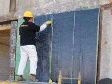 Flexural and Shear Strengthening of URM Walls with FRP Systems